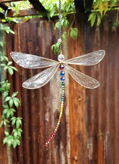 One of our Best-Selling Dragonfly Sun Catchers! This beautiful Dragonfly Ornament can hang in any window (suction cup included) or Dragonfly Wedding, Dragonfly Decor, Beaded Dragonfly, Dragonfly Necklace, Dragonfly Photos, Dragonfly Tattoo, Pendant Necklace, Wire Crafts, Bead Crafts