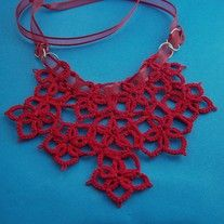 Ten starflower motifs are sewn together to make this wonderful bib necklace designed to add that special focus to your outfit.