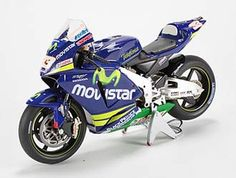 This Honda RC211V (Marco Melandri - 2005) Diecast Model Motorcycle is Blue and features working stand, steering, wheels. It is made by Ex Mag and is 1:12 scale (approx. 17cm / 6.7in long).    Please note: imperfect outer packaging on this item....