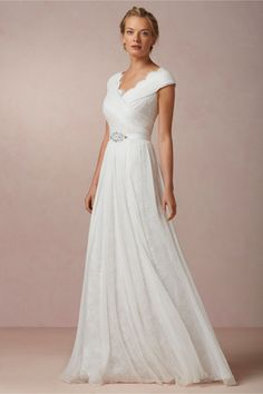 like the top and sleeves, drape of skirt, color is too white; Halcyon Gown in Bride Wedding Dresses at BHLDN