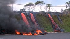 Asphalt caught fire as fingers from the Pahoa lava flow cascaded down slope a the Transfer Station. Oct 2014