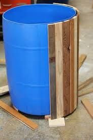 The DIY is for a backyard bar, but I want to cover my blue rain barrels in wood planks like this :)