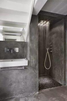 Paredes suelo y plato de ducha integrado en microcemento