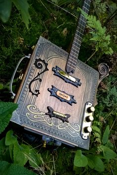The Grey Parrot custom build is finished and arrived at a very happy customer! This one is made out of a very solid Pickwick tea box. I adjusted the box and… Cigar Box Art, Cigar Box Guitar, Guitar Art, Cool Guitar, Guitar Pics, Cigar Box Nation, Cigar Box Projects, Old Musical Instruments, Best Rock Bands