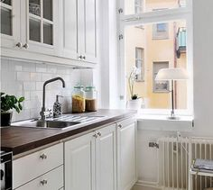 Exquisite kitchen features creamy white cabinets paired with grey and white marb. Exquisite kitchen features creamy white cabinets paired with grey and white marble countertops and a curved marble backs. Classic Kitchen, New Kitchen, Kitchen Ideas, Kitchen Decor, White Kitchens Ideas, Vintage Kitchen, Urban Kitchen, 1960s Kitchen, Victorian Kitchen