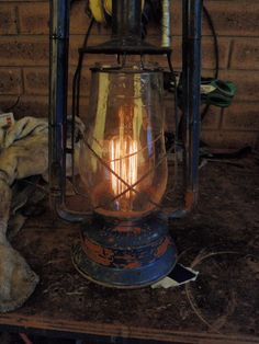 Repurpose an oil lantern into an electric table or hanging lamp -- very cool looking retrofit with a vintage/antique bulb!