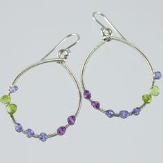 Gemstone hoop earrings of amethyst, tanzanite, vesuvianite and sterling silver, all hand wire wrapped. LauraLawranceStudio.com