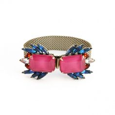 The Leda bracelet is our new go-to bracelet for cocktailing! In drop dead pink and navy hues, the clever clasp features 2 clusters of vintage blue and topaz navettes (circa 1950).