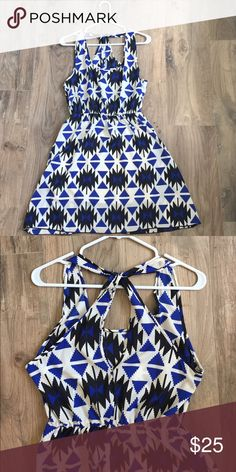 Trendy Tribal Print Sundress NWOT Never worn. Trendy tribal print in black and blue with an off white background. Elastic cinched waist. Adorable key-hole detail in back. Perfect for the upcoming Spring and Summer seasons. Skirt is lined. Size L 100% polyester  🚭non smoking home Dresses Midi