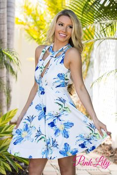 You'll have it all and more in this new dress! It features floral print in shades of blue, yellow, and green, a semi-open back with buttons at the nape of the neck, a zipper in back, and a thick band at the bottom hemline to give it a flared look. We especially love this trendy cutouts in the front, too!