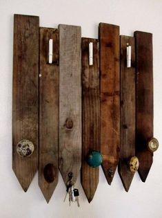 Coat rack using old door knobs and fencing