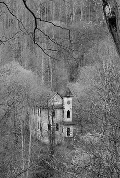 """Silenced"" -- [St. John's Baptist Church in Stotesbury, Raleigh County, West Virginia - seen from the road above. This church, built by the E.E. White Coal Company in 1918, was to provide the blacks in the Raleigh County area with a church to attend. The congregation moved to Beckley sometime in the 1980s when the area coal mines played out leaving St. John's to sit dormant."