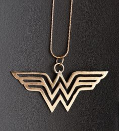 How cool.  Wonder Woman pendant ($80), also available in silver.