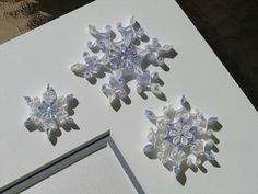Quilled Snowflakes by all things paper, via Flickr
