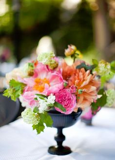 Love the contrast of a dark vase with bright flowers.
