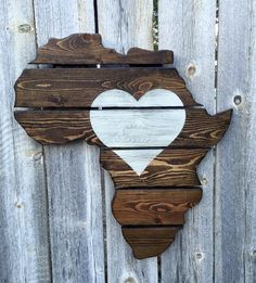 This jigsawed Africa is handmade out of upcycled pallets. The unique upcycled pallet boards are stained in espresso with the heart hand painted on in white and distressed. This piece is great for anyone who loves Africa! Please note that order may differ from pictures above based upon different grains in the wood. Each board has a unique look and combine to create this wonderful piece of art to hang on your wall!Any stain color optional.All states, countries, and symbols available.Size =...
