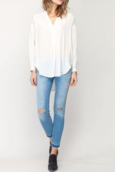 Long sleeve with cuff. Embroidery around shoulder and high low in the front to back.  Lauren Blouse by Gentle Fawn. Clothing - Tops - Blouses & Shirts Canada