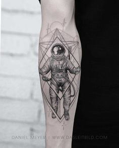 arm tattoo astronaut