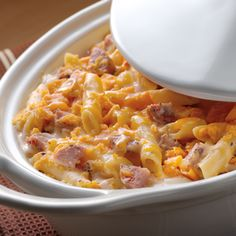 Crowd Pleasing' Cheesy Sausage Ziti is a new twist on a classic favorite! Traditional mac & cheese becomes even more delicious with the addition of chicken sausage, ziti pasta and a crispy cheddar cracker topping. Introduce macaroni and cheese devotees to their new favorite pasta dish at your next neighborhood potluck!