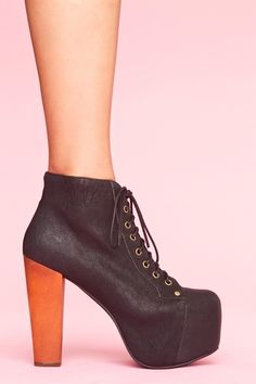 Lita Platform Boot-Black: Towering black leather lace-up boots featuring a covered platform and chunky wooden heel. Genuine leather interior, non-slip sole. Perfect paired with a tee dress and circle sunnies! By Jeffrey Campbell.