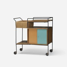Raymor  |  USA, c. 1950  |  mahogany, enameled steel, jute, lacquered wood, plastic  |  35½ w x 18 d x 32¼ h in (90 x 46 x 82 cm). Cart features two sliding doors concealing storage.