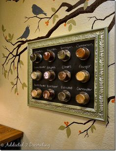 Create a framed, magnetic chalkboard to display spice jars.