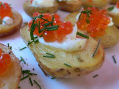 Roasted potatoes caviar and creme fraiche~ I would love to try this with red new potatoes the small size would make them delectable bite sized bits of goodness