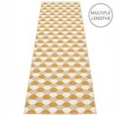 Pappelina's ochre Dana runner has a split personality!  The jacquard weave creates one side of striking hexagons in ochre, beige and vanilla, flip it over and you have a totally different graphic pattern.  We don't know how it happens but we love it!  Woven from soft plastic using traditional Swedish techniques, a Pappelina runner makes a hallway feel welcoming, and can be used in all areas of the home.  They are reversible, dust and dirt repellent and fully washable.