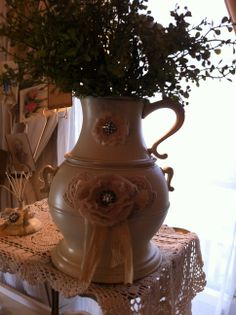 This is a vintage ice server and pitcher combination but it also makes a great vase.