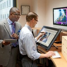 Two of Jehovah's Witnesses working in the Art Department at Bethel, U.S.A.