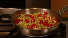 Chef Susan Elliott of Johnson & Wales University shows us how to make summer succotash, a vegetable medley with corn, lima beans, tomatoes, onion and bacon. ( I use okra instead of lima beans). ( I also use Old Bay seasoning to taste)  YUM!