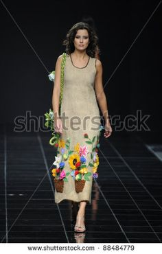 MOSCOW - OCTOBER 27: Model walks the runway at the Anna Lesnikova Collection for Spring/ Summer 2012 during Volvo Fashion Week on October 27, 2011 in Moscow, Russia
