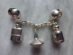 Cacharel Brooch, Rare, silver Plated Perfume Bottles. Circa 1985  Lou Lou, Anais Anais and the men's fragrance Pour Homme.