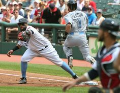 Cleveland Indians first baseman Carlos Santana grabs the throw from Yan Gomes to get the Chicago White Sox Adam Eaton in the first inning at Progressive Field  on June 19, 2016.  Indians won 3-2 (Chuck Crow/The Plain Dealer)