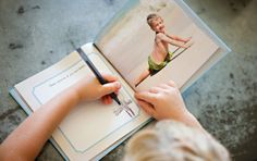 Cool photo book design from Design Aglow- leaves pages blank for kids to draw or write. Great idea for father's/mother's day...