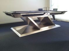 ALLURE: 8'x4' custom crafted stainless steel pool table with matching bar and wall/shelf remote control lighting feature.