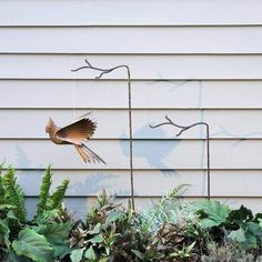 Don't settle for a plain hook! Our Single Metal Twig Stake makes a charming addition to your garden. Use it to support a delicate plant that needs a bit of propping up, or put it to work as a hook for a small ornament, bird feeder, or hummingbird feeder.   #GardenStakes #Gardenstake #gardenstake #gardenstakes #gardening #gardenlover #gardenart Garden | Gardening | Garden Art | Garden Decor | Garden Stake