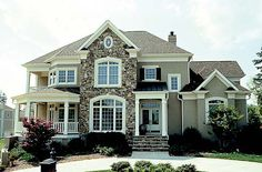 Farmhouse Traditional House Plan 85511
