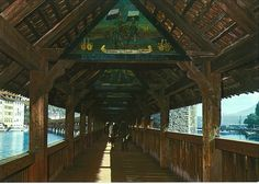 The inside of the Kapell Bridge in Lucerne, Switerland.  In the rafters are carved pictures.
