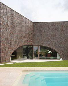 dieter de vos architecten triple brick arch house