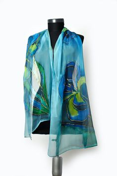 Hand painted blue silk chiffon scarf.  Beautiful hand painted silk chiffon scarf. I love paint Orchids, my favorite flowers. Hand painted silk with floral motives. LUXURY gift for spring or celebrates. Painted by hand blue orchids.This scarf is a wonderful accessory to your outfit. It gives a very fresh and elegant charm to your clothing and yourselves! It is suitable to be worn in all seasons.  The scarf is available.  dimensions: 18/70 or 50/180 cm long ---------------------------...