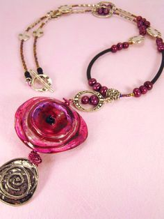 Pink flower focal pendant strung simply with bali silver and pearls.  Looks awesome on this one.