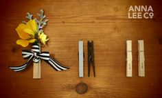 I like the clothespin idea. Also cute for pinning the napkin to place holder, menu, or whatever else you need