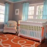 Love the pops of orange in this room. #nursery