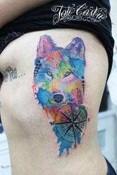Fantastic wolf watercolor tattoo on rib side for woman