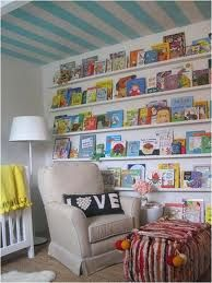 Love the bookshelves and stripes on the ceiling. Playroom?