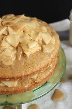 Caramel Apple Layer Cake: Brown sugar buttermilk layer cake smothered in apples cooked in a brown sugar syrup and finished with a drizzle of the easiest vanilla bean caramel sauce.