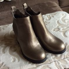 Sam & Libby bronze metallic boots. NWOT Really cute S&L bronze boots.  Small scratch on back of one heel, but never worn.  Elastic on both sides of boots.  Rubber bottoms. Sam & Libby Shoes Ankle Boots & Booties