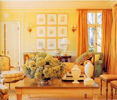 Analogous.  The pairing of the yellow walls, with the orange curtains and yellow-orange furniture creates a very unique, yet tied together room.... for the dining/front living room?