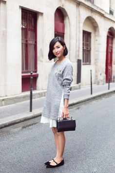 gray sweater + white skirt + black flats + black clutch